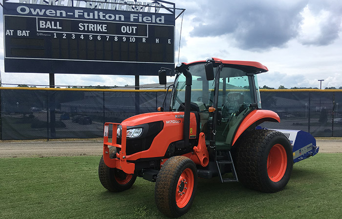 Anderson Turf Management tractor on baseball field.